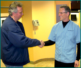 Dr. Treinkman shakes hand with patient
